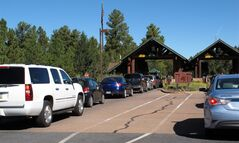 "In this Sept. 30, 2013, photo, cars line up at Grand Canyon National Park's South Rim entrance before the park was closed on Oct. 1 due to the partial government shutdown. Americans are finding that ""the government"" entails a lot more than the stereotype of faceless D.C. bureaucrats cranking out red tape. (AP Photo/Felicia Fonseca)"