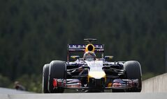 Red Bull driver Sebastian Vettel of Germany steers his car during the first free practice at the Spa-Francorchamps circuit, Belgium, Friday, Aug. 22, 2014. The Belgium Formula One Grand Prix will be held on Sunday. (AP Photo/Luca Bruno)