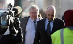 Mark Stobbe (left), accused of killing his wife, arrives at court Tuesday for his lawyer's closing arguments.