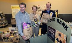 Winnipeg Harvest executive coordinator David Northcott, centre, has been invested with the Order of Canada.