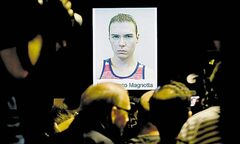 GRAHAM HUGHES / THE CANADIAN PRESS Luka Rocco Magnotta's picture is shown at news conference.