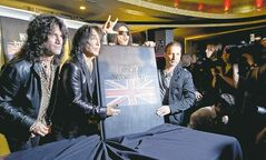 The members of KISS unveil their Monster-piece in London Tuesday. From left, Tommy Thayer, Paul Stanley, Gene Simmons and Eric Singer.