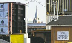 The steeple of the Salem Mennonite Brethren Church is framed by railcars at the CP Rail yards.
