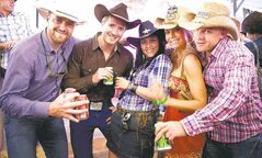 Partygoers show their Stampede spirit in a party tent run by Cowboys nightclub at the Calgary Stampede president's dinner in Calgary.