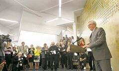 Premier Greg Selinger helps unveil Manitoba Start's new digs on Portage Avenue Wednesday.