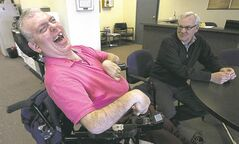 Laurie Beachell of the Council of Canadian with Disabilities (right) visits with Ron Wall.