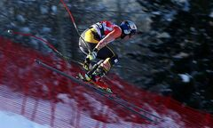 Canada's Erik Guay competes during an alpine ski, men's World Cup downhill training, in Bormio, Italy, Saturday, Dec. 28, 2013. (AP Photo/Alessandro Trovati)
