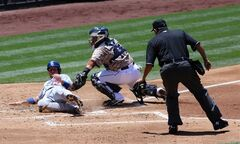 San Diego Padres catcher Rene Rivera tags out Los Angeles Dodgers' A.J. Ellis at home during the second inning of a baseball game Sunday, June 22, 2014, in San Diego. (AP Photo/Don Boomer)