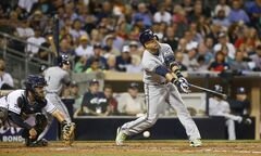 Milwaukee Brewers' Aramis Ramirez chases a low slider in the fourth inning of a baseball game against the San Diego Padres on Tuesday, Aug. 26, 2014, in San Diego. The Padres catcher is Rene Rivera. Ramirez struck out with a runner on third. (AP Photo/Lenny Ignelzi)