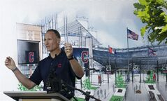 Cleveland Indians president Mark Shapiro talks about the renovations to Gate C Thursday, Aug. 7, 2014, in Cleveland. Gate C will have dramatic views of the Cleveland Skyline from inside the ballpark. The changes at Progressive Field will include a new two-story bar, and an expanded section for children and other amenities. Most of the changes will be in the right-field sections. The work is expected to be mostly completed by opening day next season and will reduce seating capacity from 43,000 to about 38,000. (AP Photo/Tony Dejak)
