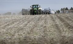 Greg Broadbent plants corn in a field on May 5, 2014, near De Soto, Iowa. =ap Charlie Neibergall