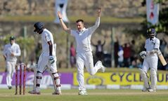 South Africa's Dale Steyn, second right, celebrates the wicket of Sri Lanka's Lahiru Thirimanne, second left, in the third day of their first test cricket match in Galle, Sri Lanka, Friday, July 18, 2014. (AP Photo/Eranga Jayawardena)