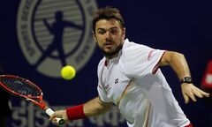 Stanislas Wawrinka of Switzerland plays a shot against Canada's Vasek Pospisil of Canada in the men's singles semifinal match at the ATP Chennai Open 2014 in Chennai, India, Saturday, Jan. 4, 2014. (AP Photo/Arun Sankar K.)
