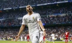 FILE - In this Wednesday, April 23, 2014 file photo, Real's Madrid's Karim Benzema celebrates scoring the opening goal during a Champions League semifinal first leg soccer match against Bayern Munich at the Santiago Bernabeu stadium in Madrid, Spain. Real Madrid says France striker Karim Benzema has agreed to extend his contract with the European champions to the end of the 2018-19 season. (AP Photo/Paul White, File)