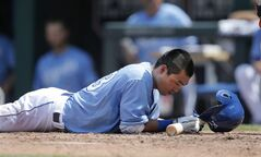 Kansas City Royals right fielder Norichika Aoki hits the ground while dodging an inside pitch during the fifth inning of a baseball game against the Houston Astros at Kauffman Stadium in Kansas City, Mo., Wednesday, May 28, 2014. (AP Photo/Orlin Wagner)