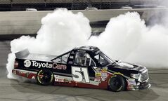 FILE - In this July 11, 2014, file phot, driver Erik Jones does a burnout after winning the NASCAR Trucks auto race at Iowa Speedway in Newton, Iowa. Jones learned this season that even the best equipment doesn't guarantee wins. But the 18-year-old broke through with a NASCAR trucks win last week, a promising sign ahead of his Nationwide debut. (AP Photo/Charlie Neibergall, File)