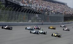 Will Power (12), of Australia, leads a group of competitors into Turn 1 at the start of the Pocono IndyCar 500 auto race on Sunday, July 6, 2014, in Long Pond, Pa. (AP Photo/Mel Evans)