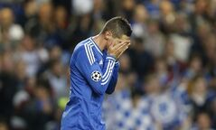 Chelsea's Fernando Torres reacts after he scored against his old club during the Champions League semifinal second leg soccer match between Chelsea and Atletico Madrid at Stamford Bridge Stadium in London Wednesday, April 30, 2014. (AP Photo/Kirsty Wigglesworth)