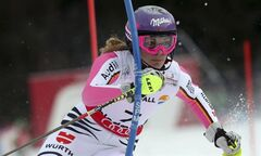 Germany's Maria Hoefl-Riesch clears a gate during the second run of the women's slalom, at the Alpine skiing world championships in Schladming, Austria, Saturday, Feb.16, 2013. (AP Photo/Luca Bruno)