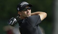Adam Scott watches his tee shot on the third hole during the first round of the PGA Colonial golf tournament in Fort Worth, Texas. Thursday, May 22, 2014. (AP Photo/LM Otero)