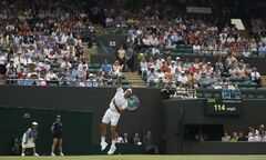 Roger Federer of Switzerland plays a return to Paolo Lorenzi of Italy during their first round match at the All England Lawn Tennis Championships in Wimbledon, London, Tuesday, June 24, 2014. (AP Photo/Pavel Golovkin)