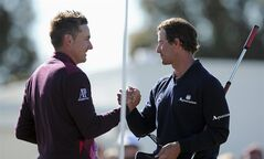 Ian Poulter, left, of England congratulates Adam Scott from Australia on the 18th green after the final round of the Australian Masters golf tournament at Kingston Heath Golf Club in Melbourne, Australia, on Sunday, Nov.18, 2012. ( AP Photo/Andrew Brownbill)