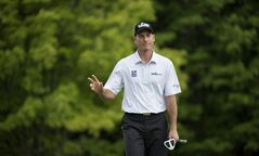 Jim Furyk, of the United States, salutes the crowd while on the 13th hole during third round of play at the Canadian Open golf championship in Montreal on Saturday, July 26, 2014. THE CANADIAN PRESS/Paul Chiasson