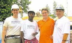 From left to right: Mathieu Allard, Samuel, Coun. Brian Mayes and Coun. Dan Vandal at the Habitat for Humanity build site on Essex Avenue.