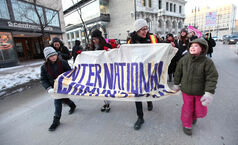 The 2012 International Women's Day March along Main Street included nine-year-old Mareigha Phelps Doran (right) and her friend Marit Stokke, also age 9, (far left) on Thursday, March 8th, 2012.