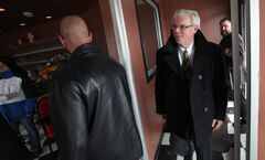 Premier Greg Selinger enters the Pots N Hands restaurant for lunch Friday in Morris.