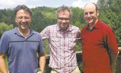 Page (centre) with Strike!  co-producers Novak (left)  and Schur.