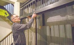 Kevin Donnelly demonstrates how to use an old pulley elevator in the Burton Cummings Theatre.