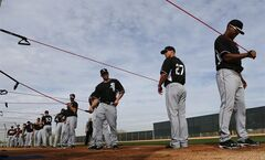 Chicago White Sox pitchers stretch during spring training baseball practice in Glendale, Ariz., Wednesday, Feb. 19, 2014. (AP Photo/Paul Sancya)