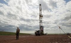 Austin Mitchell walks away from an oil derrick outside of Williston, N.D. on July 26, 2011. THE CANADIAN PRESS/AP, Gregory Bull