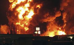 A fire burns at Red River Supply in an industrial part of Williston, N.D., early Tuesday, July 22, 2014. THE CANADIAN PRESS/AP, Josh Wood