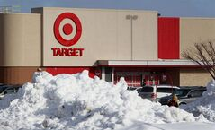 Snow is piled in the parking lot of the new Target store in Guelph, Ontario. Target announced that it is opening three pilot stores in Guelph, Fergus and Milton, Ontario March 5, 2013, the first of 124 Target stores to open in Canada, Media were given a preview tour, Monday, March 4, 2013. THE CANADIAN PRESS/Dave Chidley