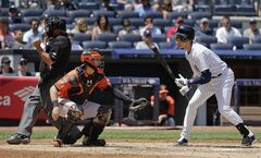 New York Yankees' Derek Jeter, right, reacts as umpire Tom Hallion calls him out on strikes to end the third inning of a baseball game against the Baltimore Orioles, Saturday, June 21, 2014, in New York. (AP Photo/Julie Jacobson)