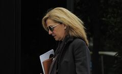 FILE - In this April 5, 2013 file photo, Spain's Princess Cristina walks towards her office in Barcelona, Spain. A Spanish court has subpoenaed Princess Cristina, the daughter of Spain's King Juan Carlos, as a suspect of tax fraud and money laundering, the latest blow to the royal family's reputation. Palma de Mallorca court judge Jose Castro on Tuesday, Jan. 7, 2014 ordered the 48-year-old princess to appear March 8 for questioning concerning investments and finances relating to her partnership with her husband Inaki Urdangarin in a firm called Aizoon. (AP Photo/Manu Fernandez, File)