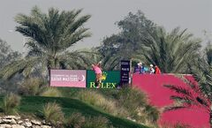 John Daly of the USA hits his tee shot on the 16th hole during the second round of the Commercial Bank Qatar Masters at the Doha Golf Club in Doha, Qatar, Thursday, Jan. 23, 2014. (AP Photo/Osama Faisal)