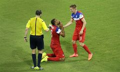 United States' John Brooks, center, celebrates with teammate Aron Johannsson after scoring their second goal during the group G World Cup soccer match between Ghana and the United States at the Arena das Dunas in Natal, Brazil, Monday, June 16, 2014. The United States defeated Ghana 2-1. (AP Photo/Hassan Ammar)