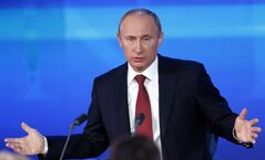 Russian President Vladimir Putin speaks during a news conference in Moscow, Russia, Thursday, Dec. 20, 2012. Putin says a draft bill banning U.S. adoptions of Russian children is a legitimate response to a new U.S. law that calls for sanctions on Russians deemed to be human rights violators. But he has not committed to signing it. (AP Photo/Alexander Zemlianichenko)