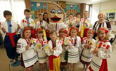 Happy Thought School's Grade 2 class in traditional dress with mascot Petrusia Perogy.