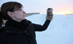 At Oak Hammock Marsh, Nathalie Bays helps Manitoba Merv check for his shadow this morning., He did, and that means six more weeks of winter.