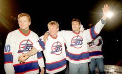 Alexei Zhamnov (from left), Thomas Steen and Teemu Selanne in their 1995-style Jets jerseys. True North won't be producing any retro wear in the near future, preferring to focus on the new logo, shown off by Andrew Ladd (above).