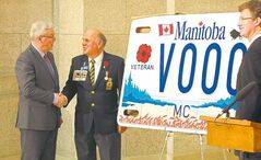 Premier Greg Selinger (from left), Rick Bennett and Justice Minister Andrew Swan unveil the new motorcycle licence plates for veterans.