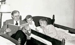 From left: Fred Koch reads to David and Charles, December 21, 1947.