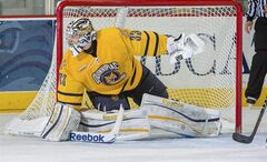 In this Dec. 7, 2012, photo provided by Quinnipiac University, Quinnipiac goalie Eric Hartzell guards the net in a game against Princeton in Hamden. Conn. The Bobcats are 18-3-3, unbeaten in their last 17 games and ranked second in the nation on Jan. 29. Hartzell leads the nation with a goals-against average of 1.46. (AP Photo/Quinnipiac University, John Hassett)
