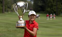 Fifteen-year-old Lydia Ko of New Zealand can hoist the trophy, but can't cash the winner's cheque. She's an amateur — for now.