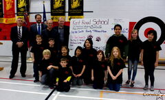 MLA Jim Maloway (Elmwood), MLA Matt Wiebe (Concordia), Mayor Sam Katz, and Coun. Thomas Steen (Elmwood-East Kildonan) pose with Kent Road School students on Jan. 22 at a press conference announcing the rebuilding of East Elmwood Community Centre. The students raised $738.65 to help reconstruct the centre, which burned down in 2011.