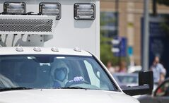 An ambulance transporting Nancy Writebol, an American missionary stricken with Ebola, arrives at Emory University Hospital, Tuesday, Aug. 5, 2014, in Atlanta. Writebol is expected to be admitted to Emory University Hospital on Tuesday, where she will join another U.S. aid worker, Dr. Kent Brantly, in a special isolation unit. (AP Photo/David Goldman)